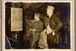 J.W. Stonehouse in a Colorado mine inspecting his safety sign. (1910)